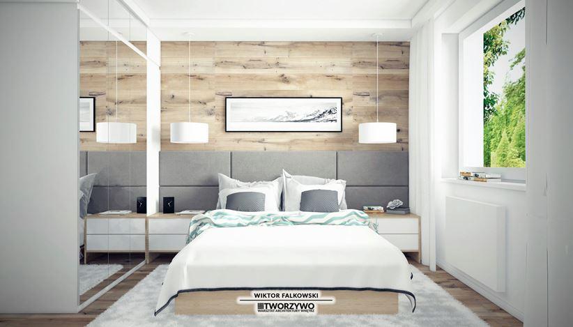 Biała sypialnia ze ścianą w drewnie