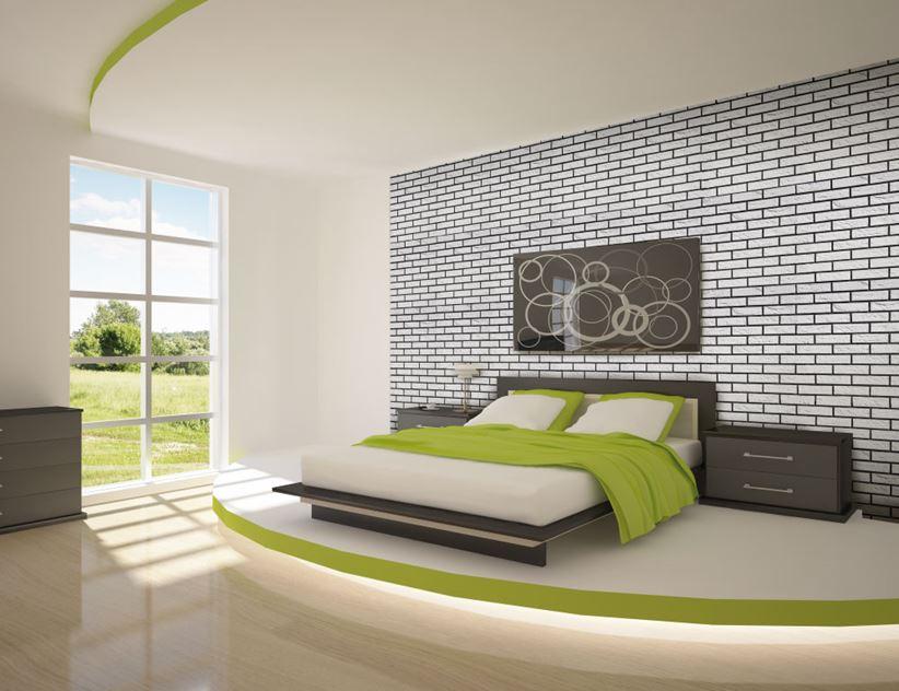 Nowoczesna sypialnia z ceglastą ścianą