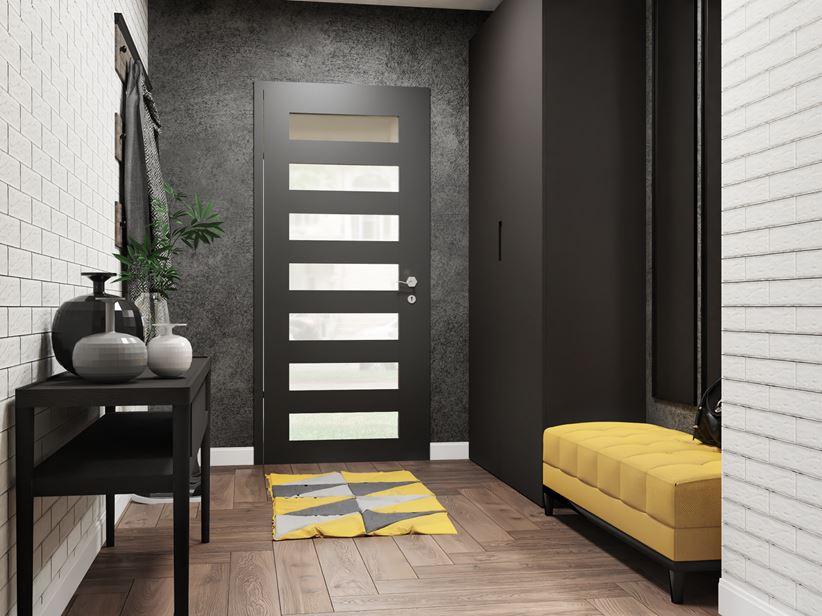 Przedpokój z drewniana podłoga i cegiełkowaną ścianą