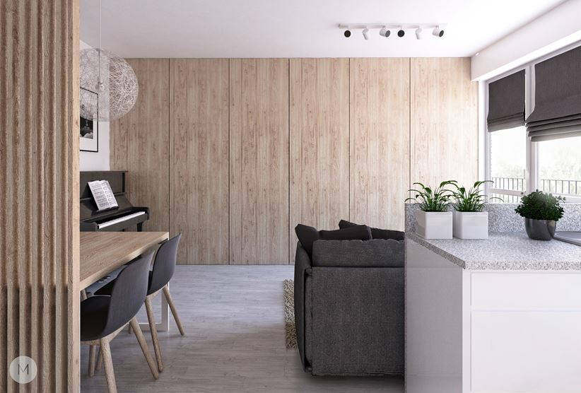 Zabudowa z drewnianymi frontami w salonie