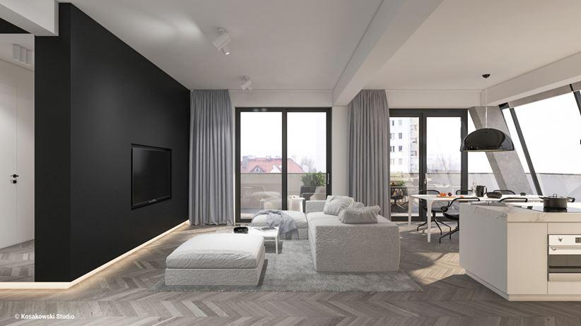 Strefa dzienna w apartamencie z czarną ścianą TV