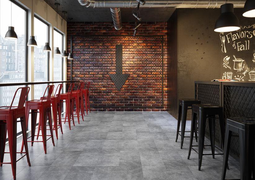Szary beton i cegła w industrialnej restauracji