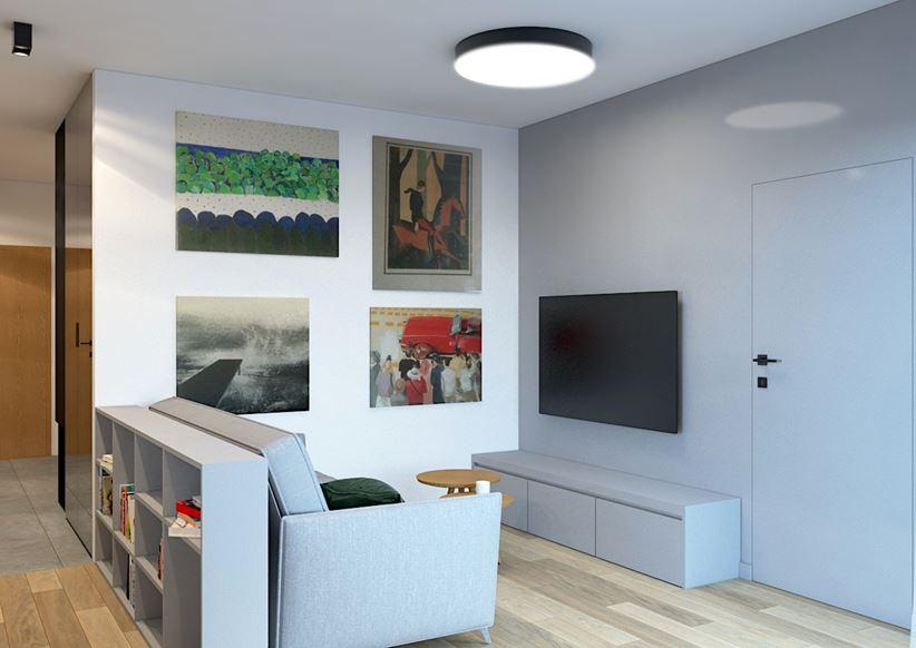 Szary salonik wypoczynkowy z galerią obrazów