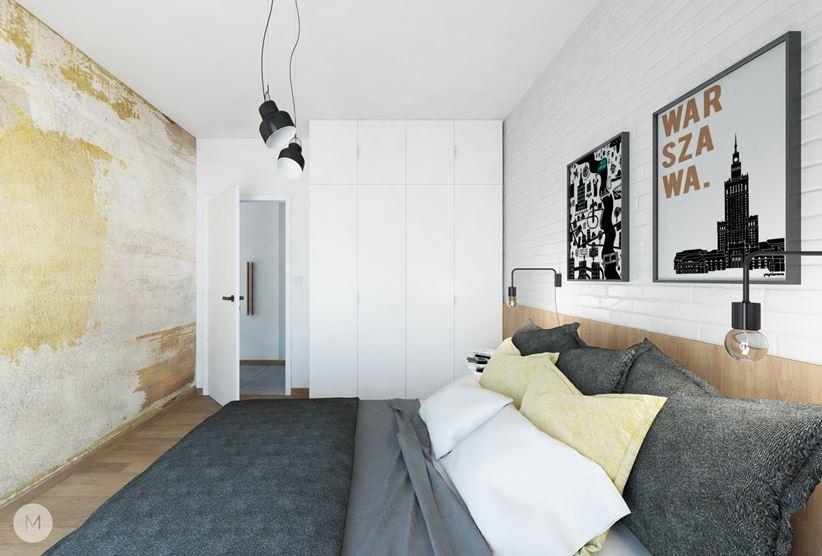 Mała sypialnia z dekoracyjnym tynkiem i cegłą