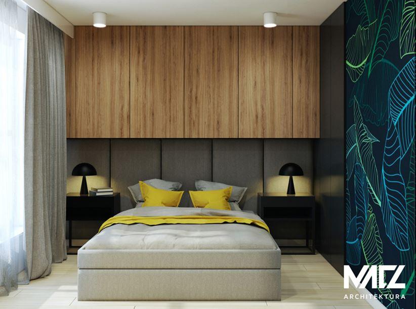 Sypialnia z tapicerowaną ścianą
