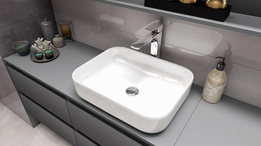 Umywalka stojąca na blacie z baterią stojącą